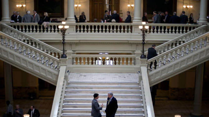 Ga. officials take lobbyist gifts before new rules