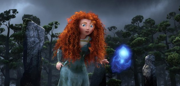 This film image released by Disney/Pixar shows the character Merida, voiced by Kelly Macdonald, following a Wisp in a scene from &quot;Brave.&quot; (AP Photo/Disney/Pixar)