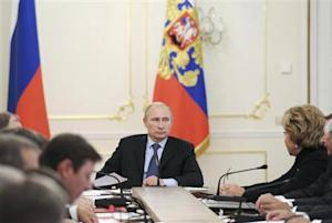 Russian President Vladimir Putin chairs a meeting with members of the Security Council at the Novo-Ogaryovo residence outside Moscow