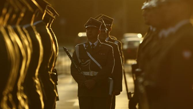 Honor guards stand in front of the Monument to the Fallen and Murdered in the East in Warsaw