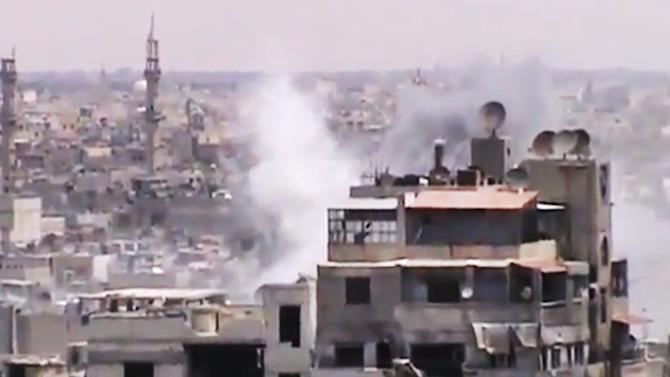This image made from amateur video released by the Shaam News Network and accessed Monday, June 18, 2012, purports to show smoke rising from buildings in Homs, Syria. Syrian forces renewed shelling of the central city of Homs on Monday, one day after the head of the U.N. observers' mission demanded that warring parties allow the evacuation of women, children, elderly and sick people, activists said. (AP Photo/Shaam News Network via AP video) TV OUT, THE ASSOCIATED PRESS CANNOT INDEPENDENTLY VERIFY THE CONTENT, DATE, LOCATION OR AUTHENTICITY OF THIS MATERIAL