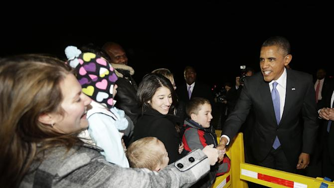 President Barack Obama greets guests on the tarmac upon his arrival at Philadelphia International Airport, Thursday, Nov. 14, 2013. Obama traveled to Pennsylvania to raise campaign money benefiting the Democratic Senatorial Campaign Committee. (AP Photo/Pablo Martinez Monsivais)