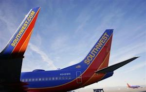 A Southwest Airlines jet waits on the tarmac at Denver International Airport in Denver