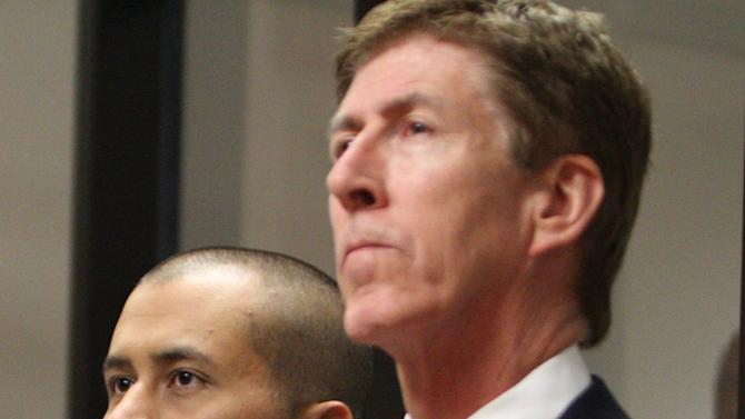 George Zimmerman, left, stands with his attorney Mark O'Mara during a court hearing Thursday April 12, 2012, in Sanford, Fla.  Zimmerman has been charged with second-degree murder in the shooting death of the 17-year-old Trayvon Martin. (AP Photo/Gary W. Green, Orlando Sentinel, Pool)