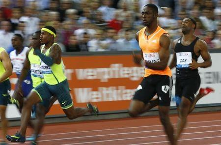 Rogers of the U.S., Bailey-Cole of Jamaica and Gay of the U.S. compete in the men's 100m A event of the Weltklasse Diamond League meeting at the Letzigrund stadium in Zurich