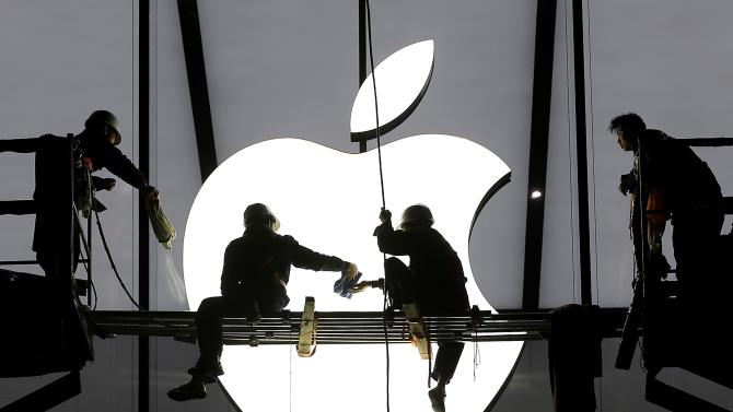 File photo of workers preparing for the opening of an Apple store in Hangzhou
