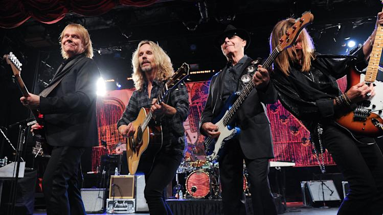 "IMAGE DISTRIBUTED FOR HARD ROCK INTERNATIONAL - From left, musicians James ""J.Y."" Young, Tommy Shaw, Chuck Panozzo and Ricky Phillips of the band Styx, perform at Eric Clapton's Crossroads Guitar Festival artist party at The Hard Rock Cafe New York on Thursday, April 11, 2013 in New York City, New York. (Photo by Evan Agostini/Invision for Hard Rock International/AP Images)"