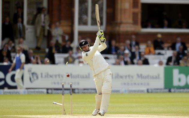 New Zealand's Martin is bowled by England's Stuart Broad during the first test cricket match at Lord's cricket ground in London