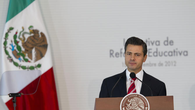 Mexico's President Enrique Pena Nieto delivers a speech during an event to announce an education reform proposal in Mexico City, Monday, Dec. 10, 2012. Pena Nieto is proposing sweeping reforms to the public education system widely seen as moribund, taking on Elba Esther Gordillo, an iron-fisted union leader who is considered the country's most powerful woman and the main obstacle to change. (AP Photo/Alexandre Meneghini)
