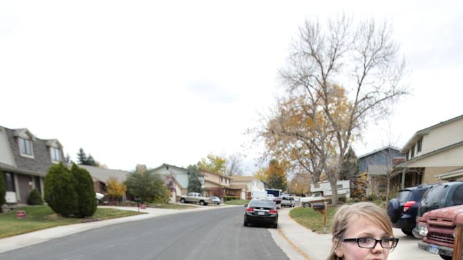 "Brooke Olds, 13, stands on the street where she would play frequently, see or talk to Austin Reed Sigg who she knew since she was four years old. ""He (Sigg)  would play capture the flag with us.  He always wanted to hang out with us girls, "" Olds said. Sigg lived down the street from Olds and was arrested for the murder of Jessica Ridgeway Wednesday, Oct. 24, 2012 in Westminster, Colo. (AP Photo/Barry Gutierrez)"