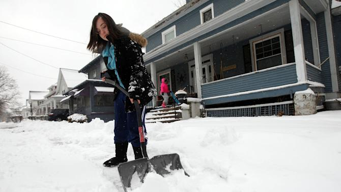 Alicia Gutierrez, 15, shovels the walk outside her home Tuesday Feb. 26, 2013 along South Main Street in Burlington, Iowa. The Burlington area saw about 4-5 inches of snow accumulation during Tuesday's storm. (AP Photo/The Hawk Eye, Brenna Norman)