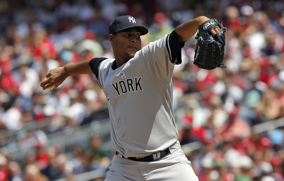 New York Yankees starting pitcher Ivan Nova throws during the second inning of a baseball game with the Washington Nationals at Nationals Park, Sunday, June 17, 2012, in Washington. (AP Photo/Alex Brandon)