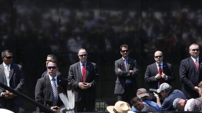 U.S. Secret Service agents watch the crowd during a speech by President Obama in Washington, May 28, 2012.