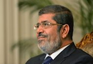 "Egyptian President Mohamed Morsi, pictured on November 21, assumed sweeping powers on Thursday, drawing criticism he was seeking to be a ""new pharoah"" and raising questions about the gains of last year's uprising to oust Hosni Mubarak"