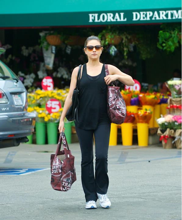Running errands after exercise looks WAY better when your look is monochrome with great-fitting yoga pants, like Mila Kunis. (Dean/NPG)