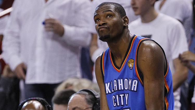 Oklahoma City Thunder small forward Kevin Durant (35) reacts while sitting on the scorers table during the second half at Game 4 of the NBA finals basketball series against the Miami Heat, Tuesday, June 19, 2012, in Miami.  (AP Photo/Lynne Sladky)