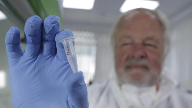 Undated photo made available by Britain's Channel 4 television Thursday Oct.17 2013 of Oxford University genetics professor Bryan Sykes posing with a prepared DNA sample taken from hair from a Himalayan animal. Sykes says he may have solved the mystery of the Abominable Snowman — the elusive ape-like creature of the Himalayas also known as the Yeti. He thinks it's a bear, based on two samples sharing a genetic fingerprint with a polar bear jawbone found in the Norwegian Arctic that is at least 40,000 years old. His findings, yet to be published, will be aired in a TV show in the UK Sunday. (AP Photo/ Channel 4)