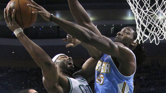 Boston Celtics power forward Chris Wilcox, center, goes to the hoop against Denver Nuggets small forward Kenneth Faried, right, during the first half of an NBA basketball game in Boston, Sunday, Feb. 10, 2013. (AP Photo/Elise Amendola)