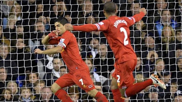 Liverpool's Luis Suarez (L) celebrates after scoring a goal against Tottenham Hotspur during their English Premier League soccer match at White Hart Lane in London December 15, 2013. REUTERS