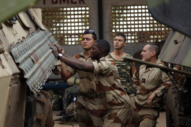 French troops gather in a hangar at Bamako's airport Tuesday Jan. 15 2013.  French forces led an all-night aerial bombing campaign Tuesday to wrest control of a small Malian town from armed Islamist e