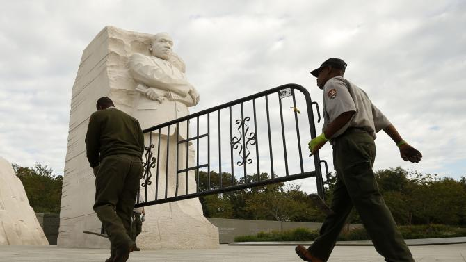 National Park workers remove barricade at the Martin Luther King Jr. Memorial as it reopens to the public in Washington