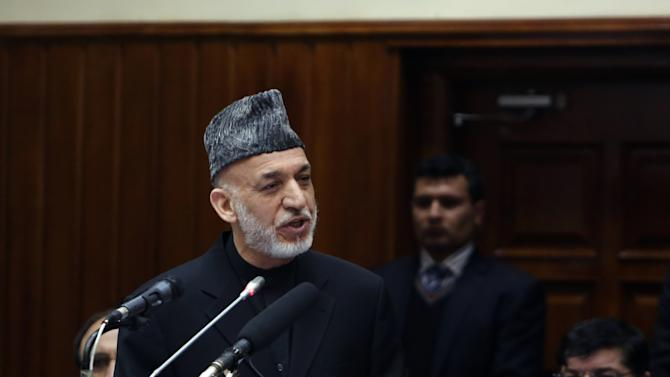 """Afghan President Hamid Karzai speaks during his final address to parliament during its opening session at the parliament house in Kabul, Afghanistan, Saturday, March 15, 2014. Karzai said the last 12 years of war were """"imposed"""" on Afghans, a reference to the U.S.-led invasion that ousted the Taliban. (AP Photo/Rahmat Gul)"""