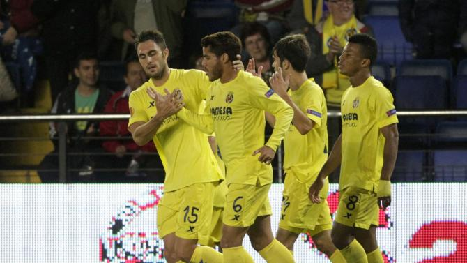 Villarreal's players celebrate after they scored a goal against Borussia Monchengladbach during their Europa League soccer match at the Madrigal stadium in Villarreal