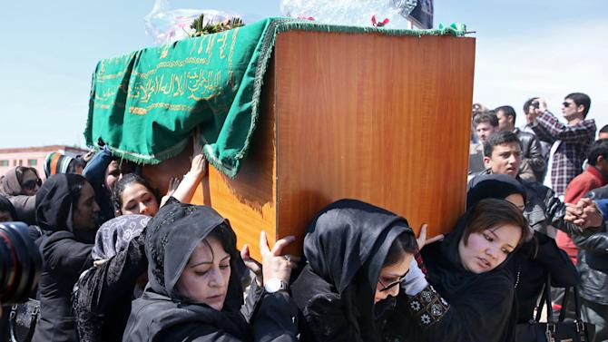 FILE - In this Sunday, March 22, 2015 file photo. Afghan women rights activists carry the coffin of 27-year-old Farkhunda, an Afghan woman who was beaten to death by a mob, during her funeral, in Kabul. An Afghan court overturned the death sentences for four men convicted of taking part in the shocking mob killing of a woman outside a Kabul shrine, a judge said on Thursday. (AP Photo/Massoud Hossaini)