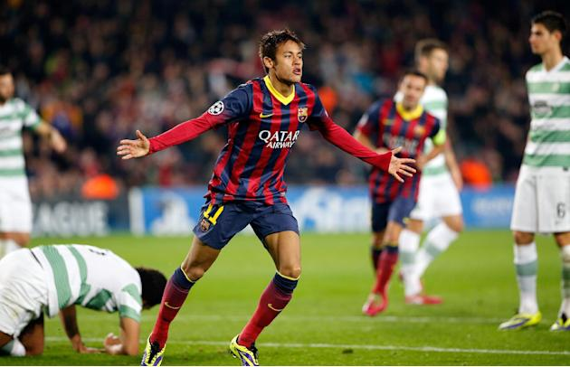 Barcelona's Neymar celebrates after scoring his side's fourth goal during a Group H Champions League soccer match between FC Barcelona and Celtic FC at the Camp Nou stadium in Barcelona, Spain