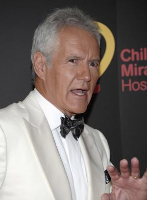 FILE - In this June 19, 2011 file photo, television personality Alex Trebek arrives at the 38th Annual Daytime Emmy Awards in Las Vegas. Trebek says he snapped his Achilles tendon while running after a burglar who had stolen cash, a bracelet and other items from his San Francisco hotel room. (AP Photo/Dan Steinberg, File)