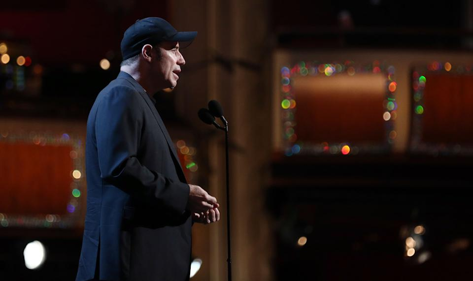 Actor John Travolta speaks during rehearsals for the 85th Academy Awards in Los Angeles, Saturday, Feb. 23, 2013. The Academy Awards are scheduled for Sunday, Feb. 24, 2013. (Photo by Matt Sayles/Invision/AP)
