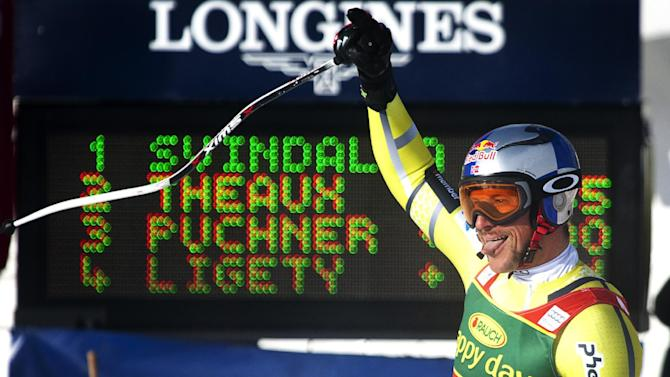 Norway's Aksel Lund Svindal celebrates his win following the men's World Cup super-G ski race event in Lake Louise, Alberta, Sunday Nov. 25, 2012. (AP Photo/The Canadian Press, Jeff McIntosh)
