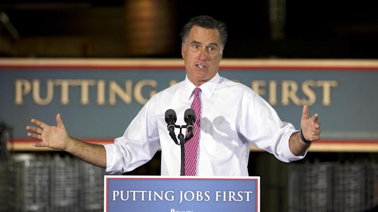 Republican presidential candidate, former Massachusetts Gov. Mitt Romney gestures during a campaign stop at Seilkop Industries in Cincinnati, Ohio, Thursday, June 14, 2012.  (AP Photo/Evan Vucci)