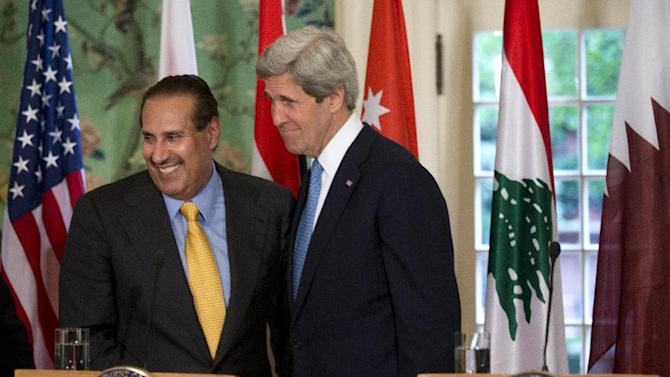 Secretary of State John Kerry, right and Qatar's Prime Minister and Foreign Minister Hamad bin Jassim bin Jabr Al-Thani, who is leading the Arab League, smile, during a news conference following their meeting at Blair House in Washington, Monday, April 29, 2013.   (AP Photo/Manuel Balce Ceneta)