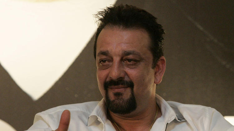 "FILE - In this June 5, 2010 file photo, Indian Bollywood actor Sanjay Dutt speaks during a press conference promoting his new Bollywood film ""Knock Out"" at the International Indian Film Academy awards event in Colombo, Sri Lanka. India's Supreme Court gave Dutt more time to finish films before he goes to prison for a 1993 weapons conviction linked to a deadly terror attack. Dutt had appealed to the court that he needed six months to complete his pending film commitments. He was supposed to surrender Thursday, and the court Wednesday, April 17, 2013 ordered the deadline extended by four weeks. (AP Photo/Chamila Karunarathne, File)"