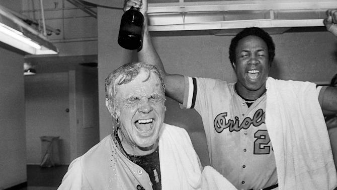 FILE - In this Saturday, Oct. 6, 1979 file photo, Baltimore Orioles manager Earl Weaver, left, is soaked with champagne after the Orioles defeated the California Angeles 8-0 to win the American League championship, in Anaheim, Calif.  Weaver, the fiery Hall of Fame manager who won 1,480 games with the Baltimore Orioles, has died, the team announced Saturday, Jan. 19, 2013. He was 82. (AP Photo/File)