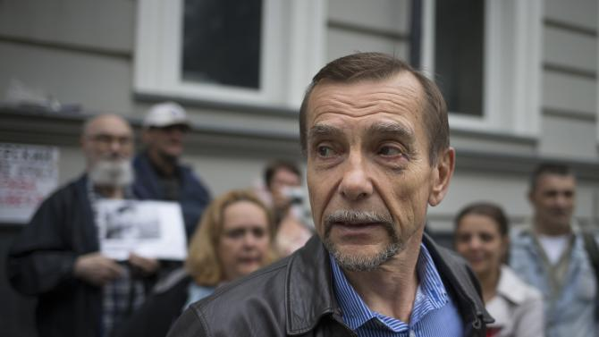 Russian human rights activist Lev Ponomarev speaks to the media at the For Human Rights movement headquarters in Moscow, Russia, Saturday, June 22, 2013. Law enforcement officers forcibly evicted the head of one of Russia's leading human rights groups and about a half dozen staff from their Moscow office early Saturday, in the latest in a series of attacks on Russian non-governmental organizations. Lev Ponomaryov, 72, who heads For Human Rights, said he was beaten all over his body when officers stormed the building at around 3 a.m. and dragged him out. Dozens of riot police had raided the office on Friday and ordered employees to leave, but they had refused. (AP Photo/Alexander Zemlianichenko)