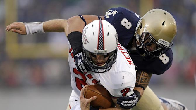 Navy tops South Alabama 42-14, qualifies for bowl