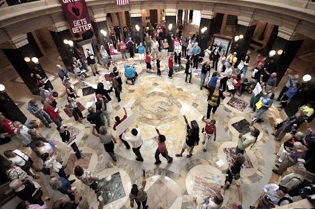 In this Sept. 7, 2012 photo, dozens of singers gather in the state Capitol rotunda for the 455th consecutive Solidarity sing along in the wake of a crackdown on protests without a permit by new Capitol Police Chief David Erwin. Most of the demonstrations against Wisconsin Gov. Scott Walker ended a long time ago. But every weekday at noon, a few dozen people still gather inside the state Capitol and sing protest songs for an hour. (AP Photo/Wisconsin State Journal, John Hart)