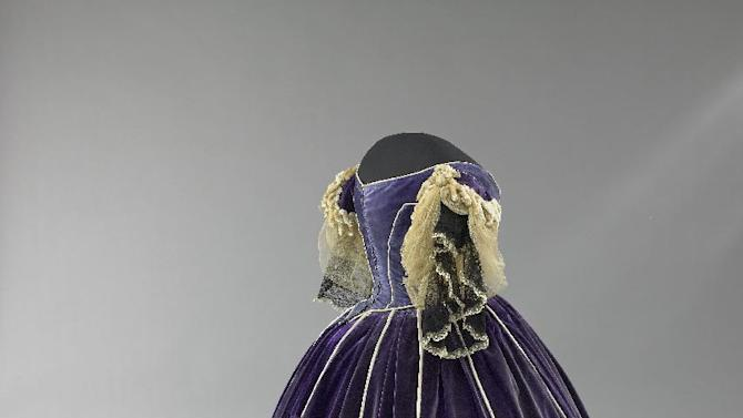 """This undated image provided by the Smithsonian's National Museum of American History shows Mary Todd Lincoln's purple velvet gown from """"The First Ladies"""" exhibit. The gown was made by her seamstress and confidante, Elizabeth Keckley, an African-American woman who had purchased her own freedom. It's one a number of artifacts associated with President Lincoln and his family in the Smithsonian collection. (AP Photo/Smithsonian's National Museum of American History)"""