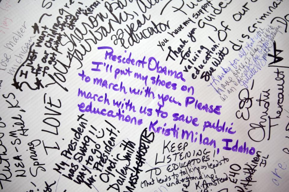 A banner of signatures in support of President Obama is on display at the National Education Association's annual convention in Washington, on Thursday, July 5, 2012. (AP Photo/Jacquelyn Martin)
