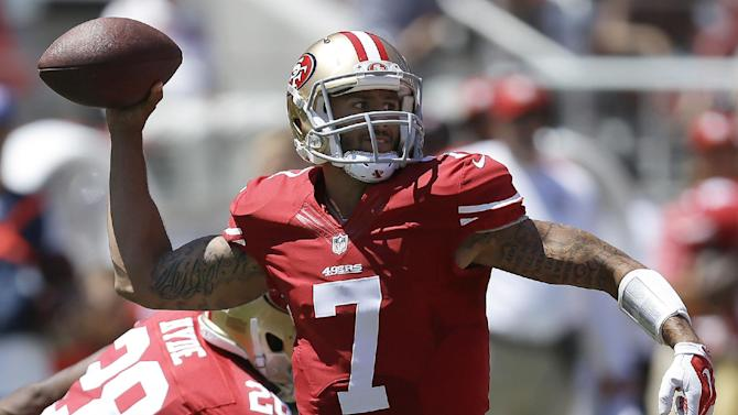 In this Aug. 17, 2014, file photo, San Francisco 49ers quarterback Colin Kaepernick (7) passes against the Denver Broncos during the first quarter of an NFL preseason football game in Santa Clara, Calif. Kaepernick is locked up long-term  and he will have tight end Vernon Davis, and wide receivers Michael Crabtree, Anquan Boldin and Stevie Johnson as targets all season