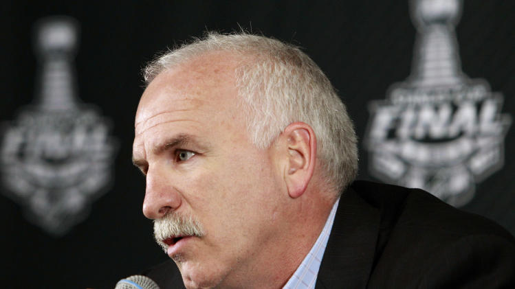 Chicago Blackhawks head coach Joel Quenneville answers a reporter's question during a media availability Sunday, June 23, 2013, in Boston. The Blackhawks will face the Boston Bruins in Game 6 of the NHL hockey Stanley Cup Finals Monday night in Boston. (AP Photo/Bill Sikes)