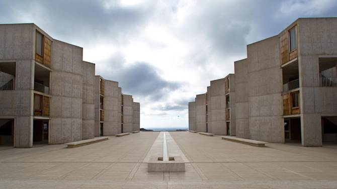 """This Oct. 3, 2013 photo shows The Salk Institute, designed by world renowned architect Louis I. Kahn, above the Pacific Ocean and adjacent the glider port and the University of California San Diego in San Diego. The nation's eighth-largest city has matured from its """"Fast Times at Ridgemont High"""" surf days. Today it boasts a burgeoning international art scene, thriving farm-to-table food movement, and a booming bio-tech industry. (AP Photo/Lenny Ignelzi)"""