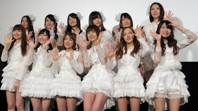 "In this Friday, Feb. 1, 2013 file photo, hugely popular Japanese girl band AKB48 members, from left in first row, Haruna Kojima, Mayu Watanabe, Minami Takahashi, Mariko Shinoda, Tomomi Itano and Rie Hitahara, and others, pose for photographers at the opening premiere of their new film ""Documentary of AKB48 No Flower Without Rain"" in Tokyo, one day after a group member shaved her head and issued a tearful videotaped apology for violating the megagroup's no-dating rule. The spectacle has sparked debate in Japan over whether the band AKB48 exerts too much control over its performers. Minami Minegishi made the video, posted on AKB48's website, after the 20-year-old was caught by a gossip magazine coming out of her boyfriend's apartment. AKB48 says it forbids its members from dating to project a clean image and signal their devotion to the group and their mostly male fans. (AP Photo/Itsuo Inouye, File)"