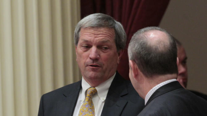 State Senate President Pro Tem Darrell Steinberg, D-Sacramento, right, tries to convince Sen. Mark DeSaulnier, D-Concord, to join other Democrats in voting for a bill to authorize  about $4.5 billion in funding for a high-speed rail system, at the Capitol in Sacramento, Calif., Friday, July 6, 2012.   The bill, which would allow the state to begin selling $2.6 billion in voter -approved bonds, was approved by a 21-16 vote and now goes to Gov. Jerry Brown who has supports the measure.   DeSaulnier was among the three Democrats in the Senate to oppose the bill.(AP Photo/Rich Pedroncelli)