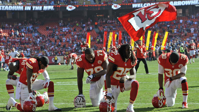 KANSAS CITY, MO - DECEMBER 02: The Kansas City Chiefs kneel and pray before a game against the Carolina Panthers on December 2, 2012 at Arrowhead Stadium in Kansas City, Missouri. (Photo by Peter Aiken/Getty Images)
