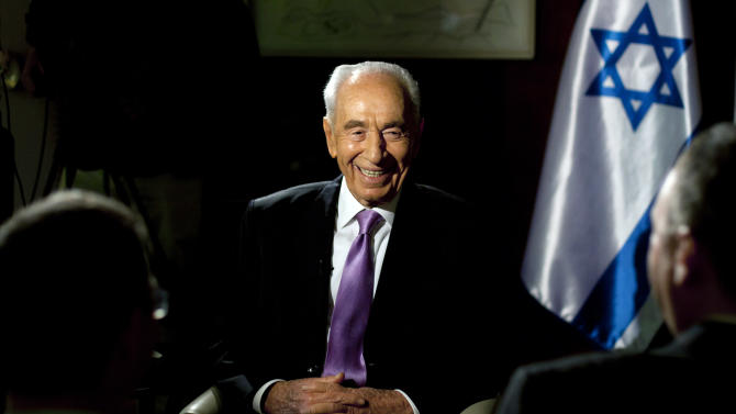 In this photo taken Sunday, June 16, 2013, Israel's President Shimon Peres, reacts during an interview with The Associated Press at the President's residence in Jerusalem. As Shimon Peres turns 90, the indefatigable Israeli president is doing what he has always done: looking ahead, preparing for the next challenge and believing that he will see Middle East peace in his lifetime. (AP Photo/Sebastian Scheiner)