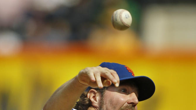 FILE - This Sept. 27, 2012 file photo shows New York Mets starting pitcher R.A. Dickey throwing against the Pittsburgh Pirates, enroute to his 20th win of the season, during the first inning of a baseball game at Citi Field in New York. Dickey is a favorite to take home the AL Cy Young Award, Wednesday, Nov. 14, 2012.  (AP Photo/Kathy Willens, FIle)