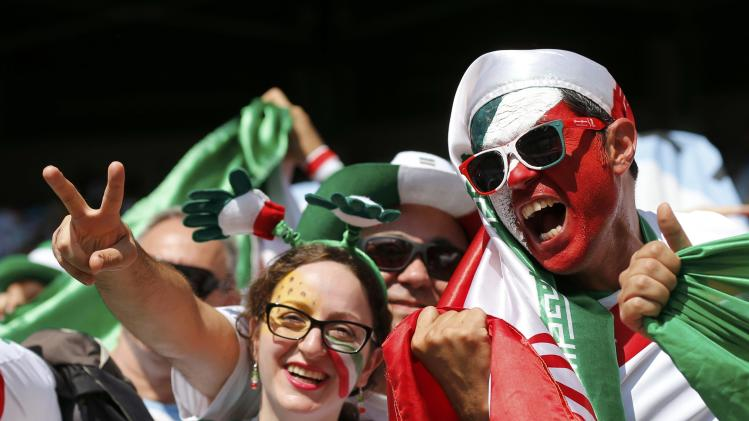 Fans of Iran cheer before their 2014 World Cup Group F soccer match against Argentina at the Mineirao stadium in Belo Horizonte